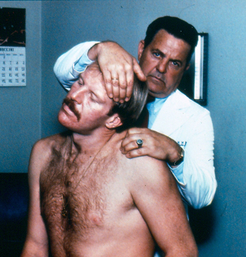 George Goodheart, founder of modern Applied Kinesiology, doing a classical manual muscle test